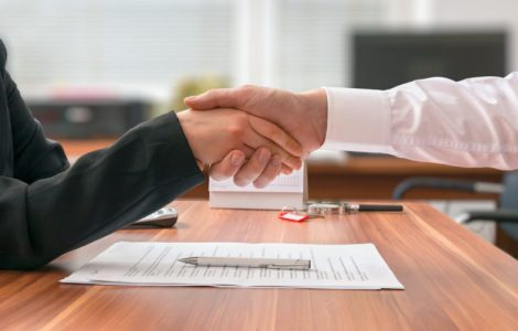 Partnership concept. Businessman and woman sitting shaking hands